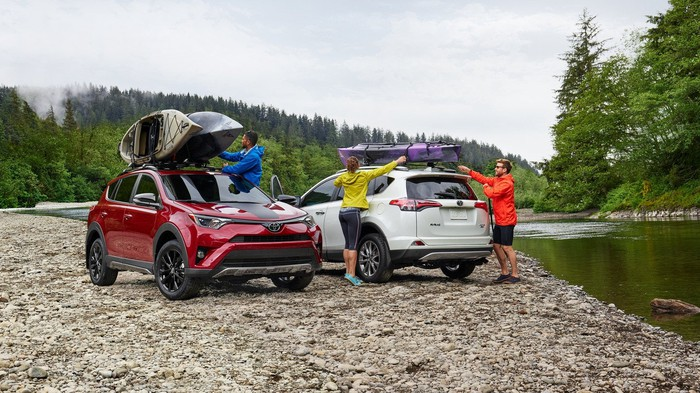 Friends with Toyota Rav4's by a river
