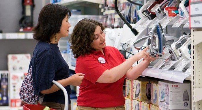 A Target employee answers a customer's question on a product.