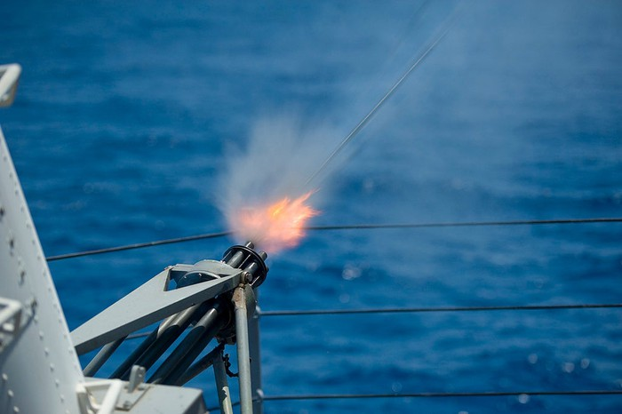 Raytheon-made Phalanx close-in weapons system firing from the deck of the USS Blue Ridge.