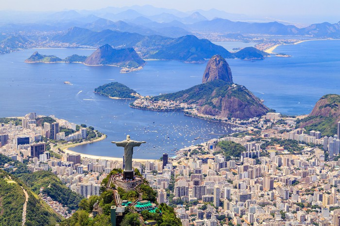 Aerial view of Rio de Janeiro, Brazil, with the Christ the Redeemer statue in the foreground