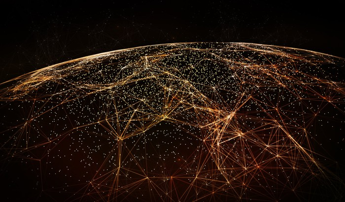 Connected world concept image, dark globe from space with orange connected points