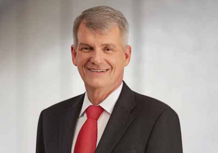 Tim Sloan, the CEO of Wells Fargo, in a dark suit and red tie.