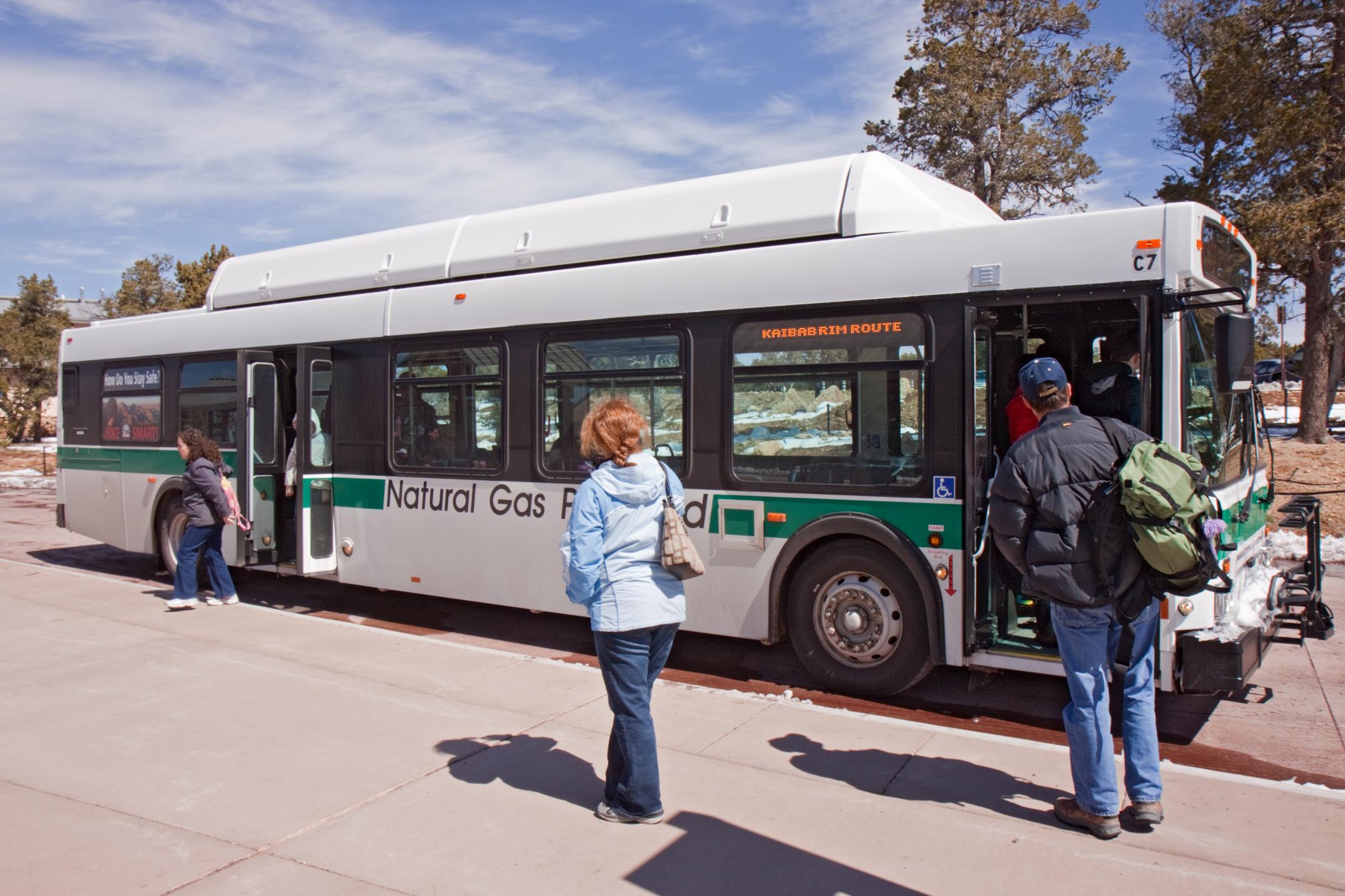 Natural gas bus picking up passengers.