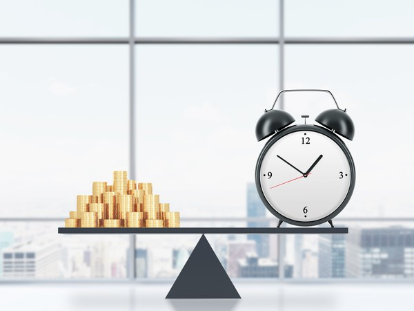 Balancing Act between Time and Money -- GettyImages-497638624