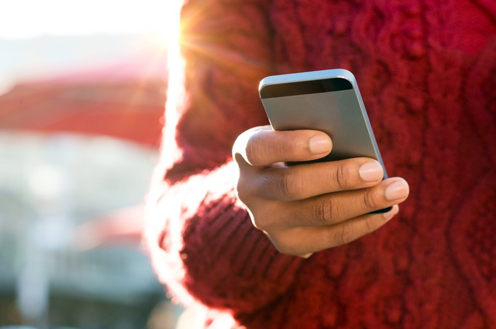 Person using a smartphone.