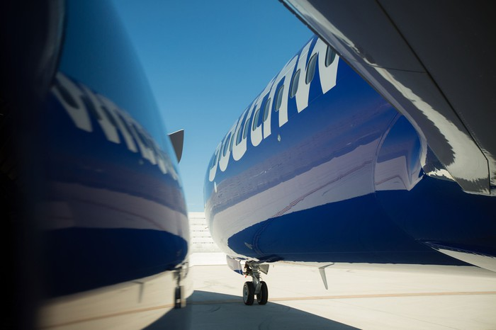 Southwest aircraft reflected on a shiny surface.