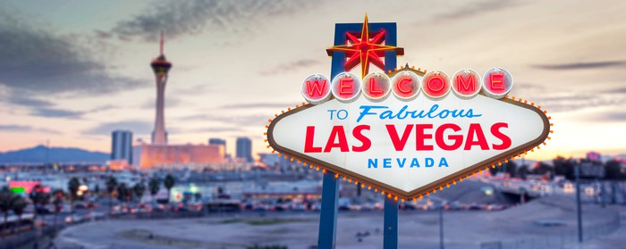 Las Vegas sign with the skyline in the background.