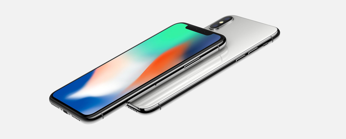 A side angle view of the front and back of the iPhone X.