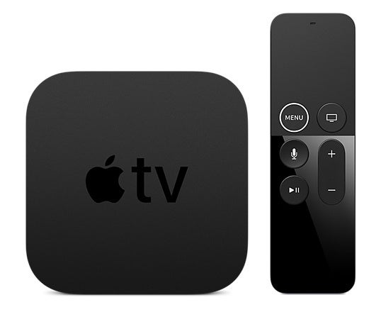 Apple TV box next to its remote.