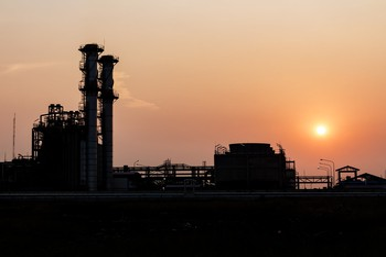 Distillation towers at sunset