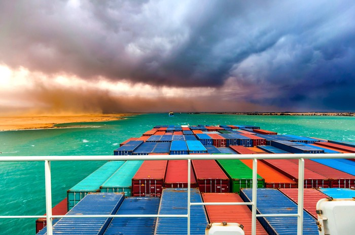A container ship heading into a storm.