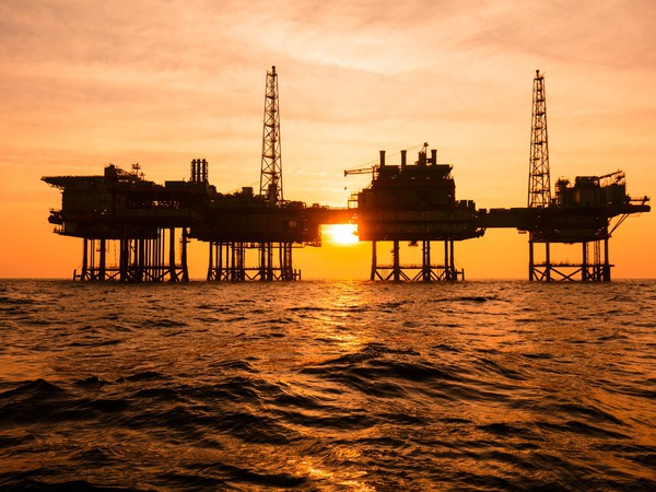 Getty Offshore Oil Rig Silhouette Sunset