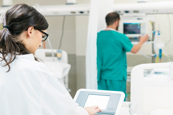 Surgery Robot Doctor at a Control Panel