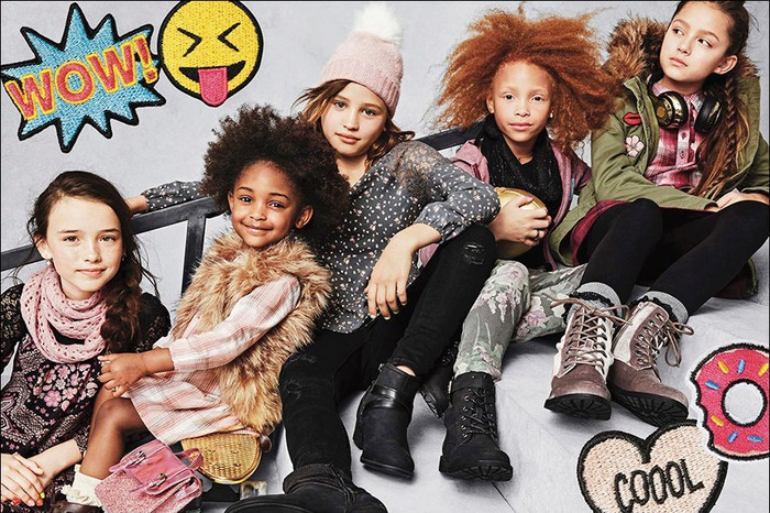 Children pose in Children's Place clothing.