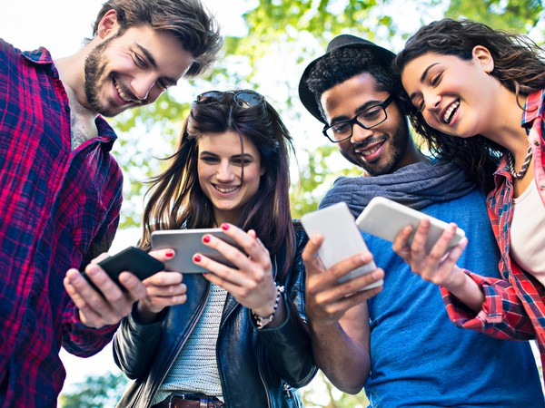 social media networking friends texting smartphones getty