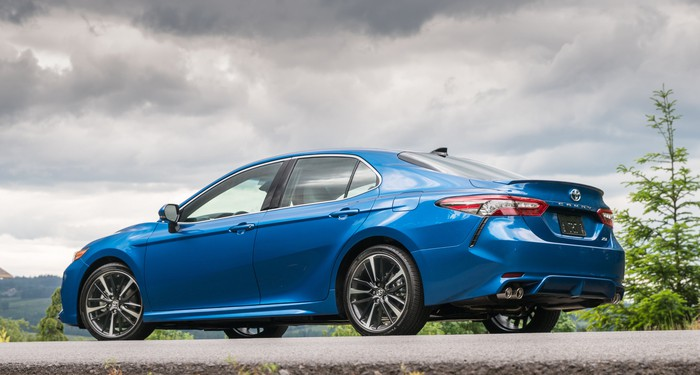 A blue 2018 Toyota Camry XSE, parked on a hill.