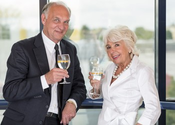 GettyImages-505921032 -- Senior couple with champaign