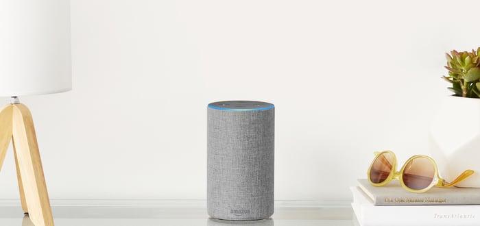 Amazon Echo sitting on a table.