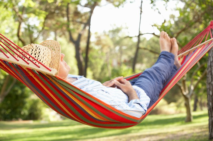 A person relaxing in a hammock.