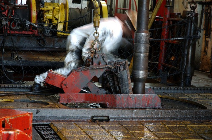 Oil rig worker setting a drill pipe.