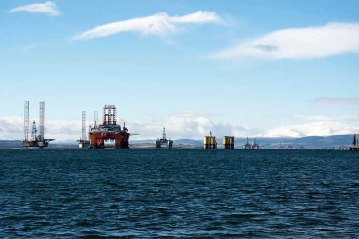 A line of idled oil rigs.
