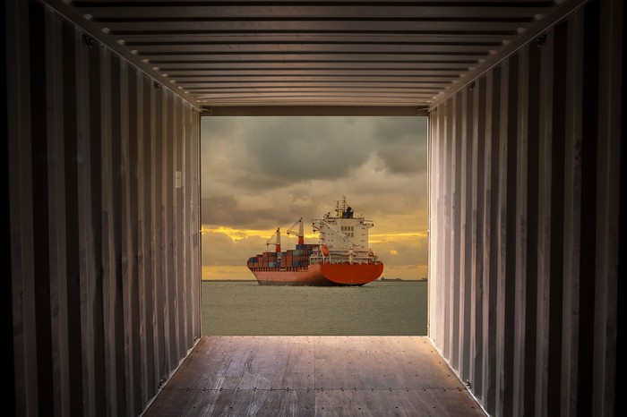 A containership viewed from a shipping container.