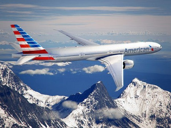 AAL Airplane over mountains IS American Airlines