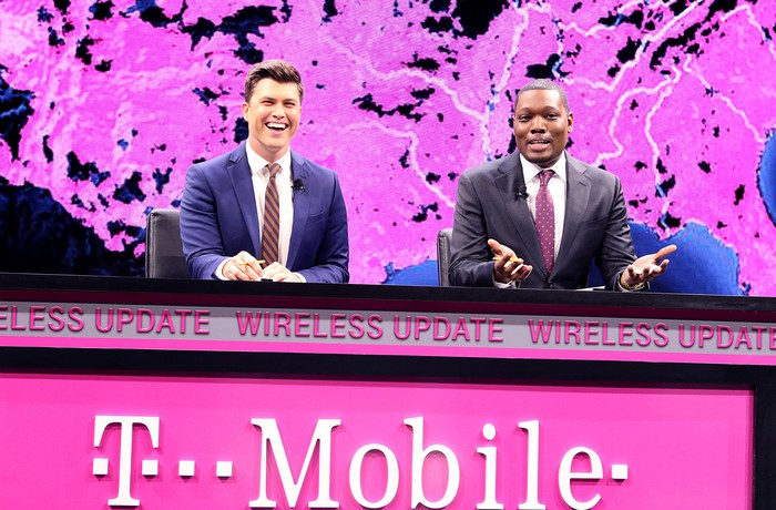 SNL's Weekend Update present a T-Mobile Wireless Update at a media event.