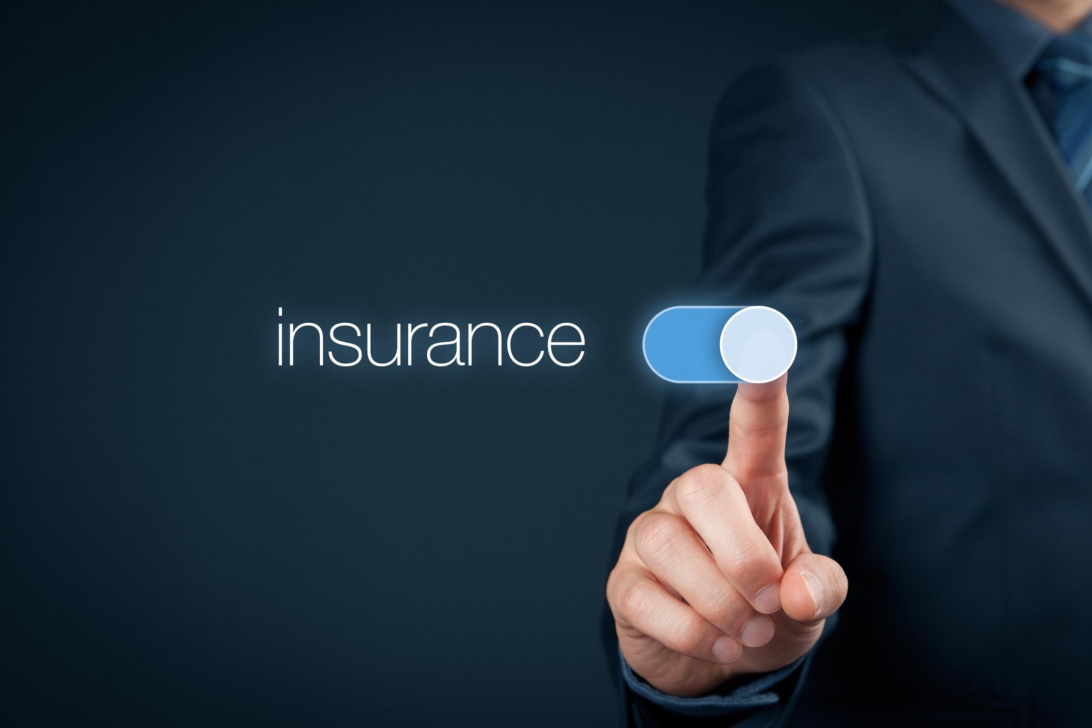 "A man touching a virtual button that says ""insurance""."