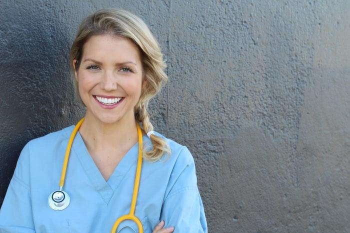 Smiling woman in scrubs