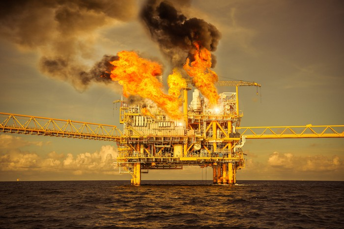 An offshore oil platform on fire.