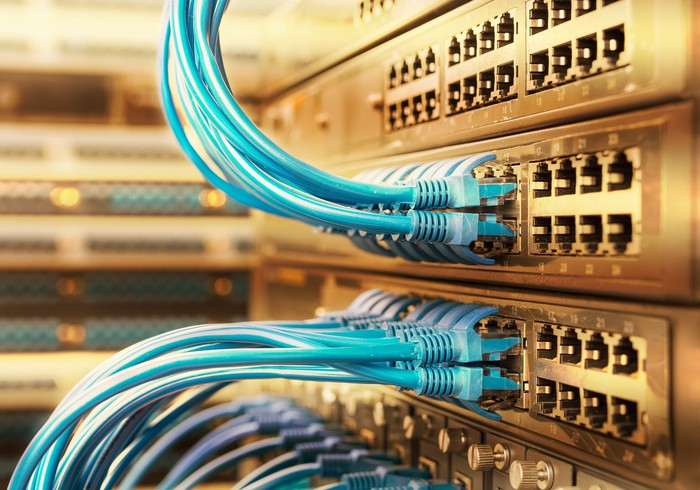 Networking hardware with ethernet cables plugged in