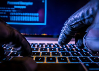 Hacker Bitcoin Cryptocurrency Money Finances Laptop Illegal Getty