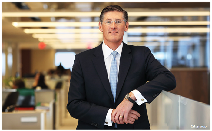 CEO of Citigroup, Michael Corbat, standing in the bank's offices.