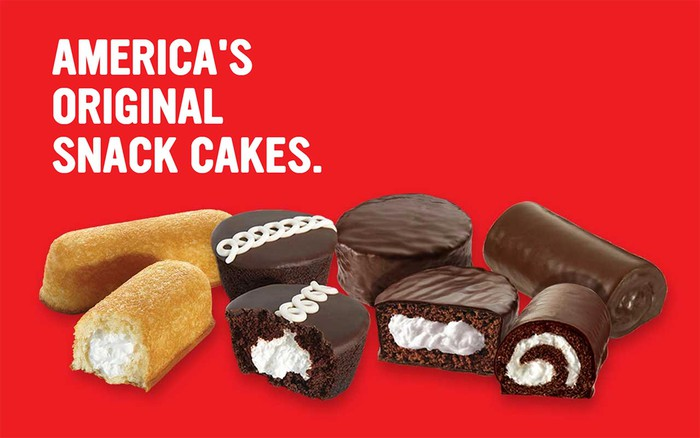"Twinkies, Ding Dongs, Ho-Hos, and cupcakes on a red background with ""America's Original Snack Cakes"" caption."