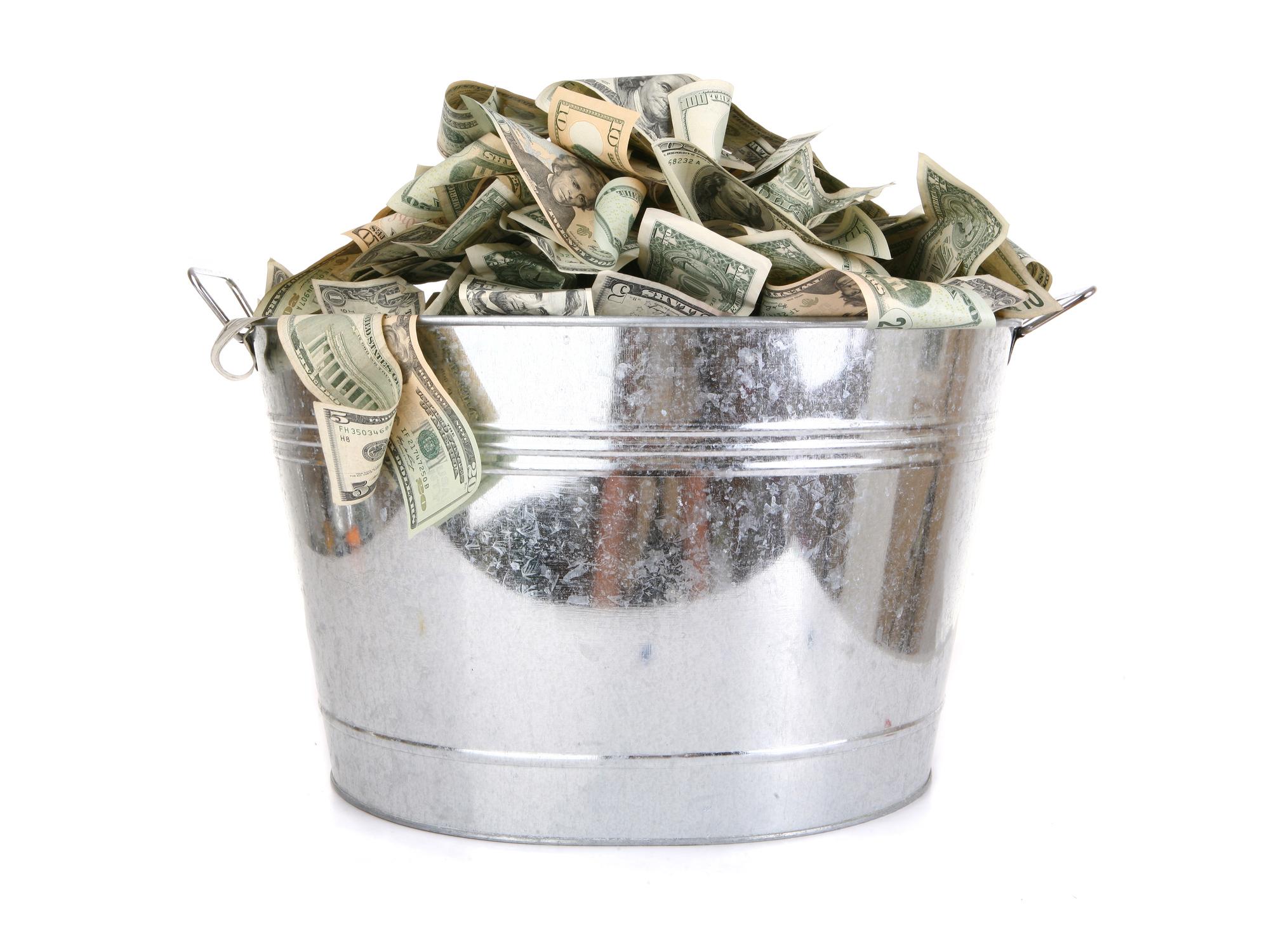 Metal bucket full of money