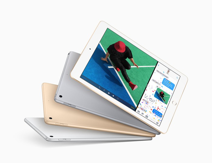 Four iPads fanned out like cards; the top one is showing an image of a person.