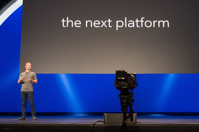 "Mark Zuckerberg on stage with ""the next platform"" on a slide"