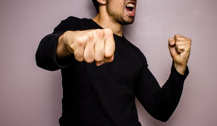 Man punching the air with his fist.