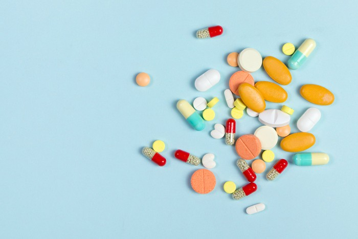 Colorful pills on a blue background.