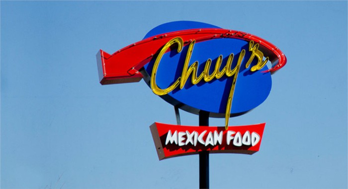 "Roadside sign showing the Chuy's logo and the text ""Mexican food."""