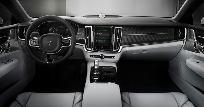 The Polestar 1's front seats and dashboard. Seats are trimmed in gray leather, and the traditional-looking dashboard is trimmed in black.