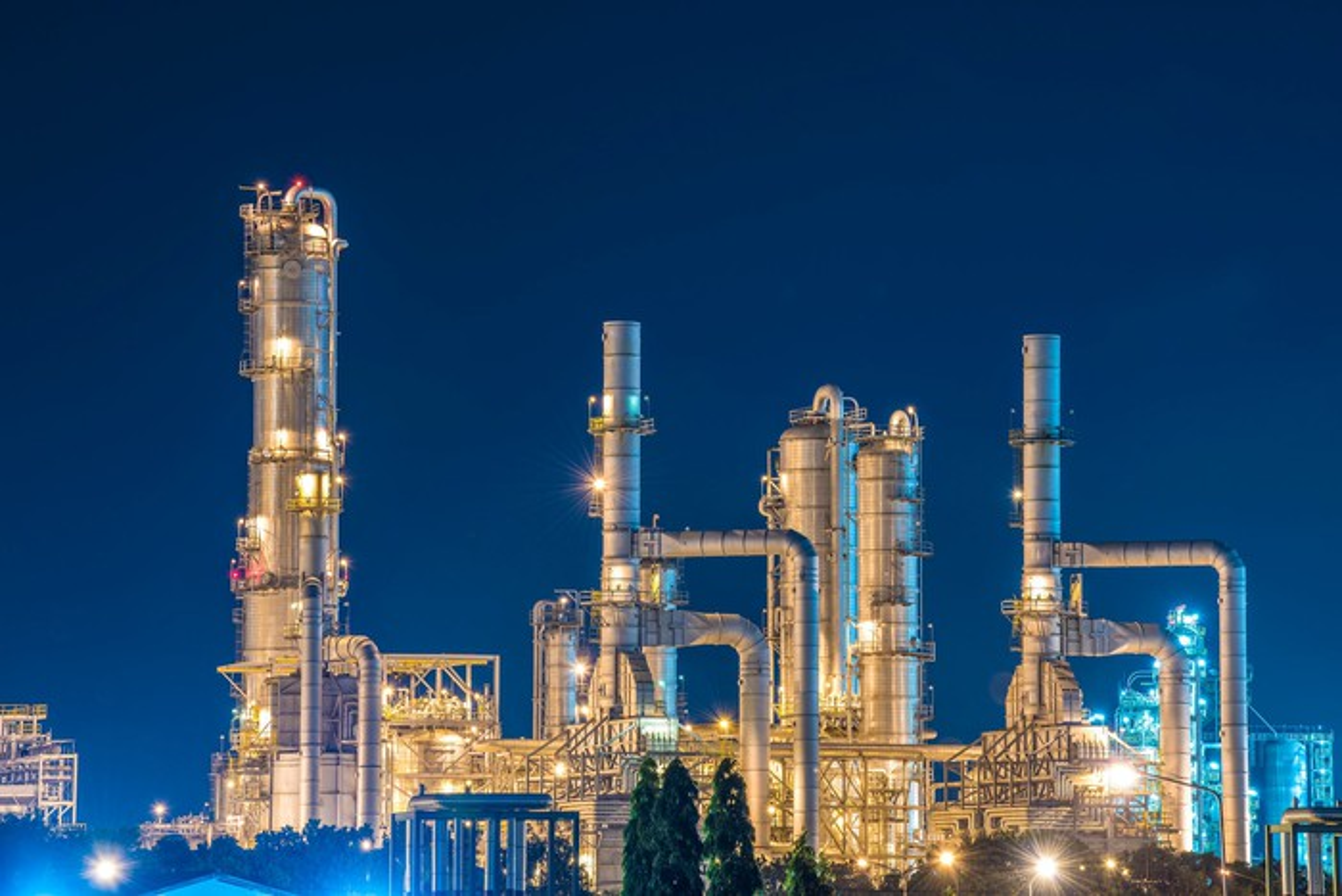 Oil refinery against dark blue sky