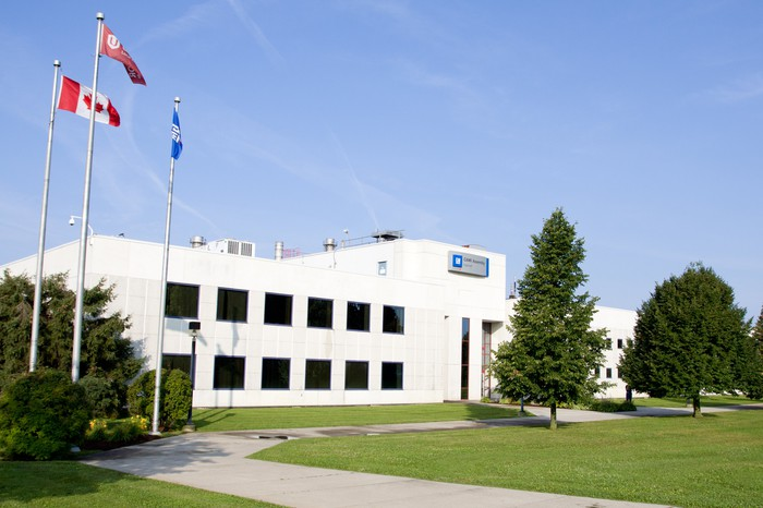 General Motors CAMI Assembly Plant in Ingersoll, Ontario, a white building with a green lawn in front.