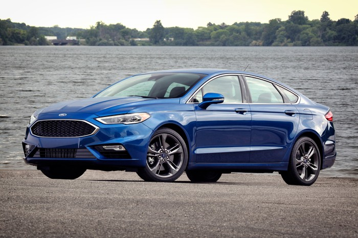 A blue 2017 Ford Fusion Sport midsize sedan.