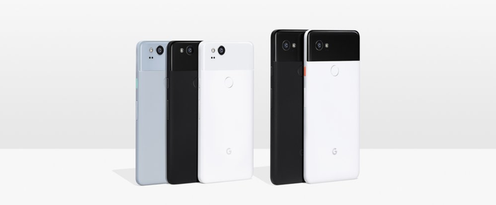 Different colors of Pixel 2 and Pixel 2 sitting vertically on a table