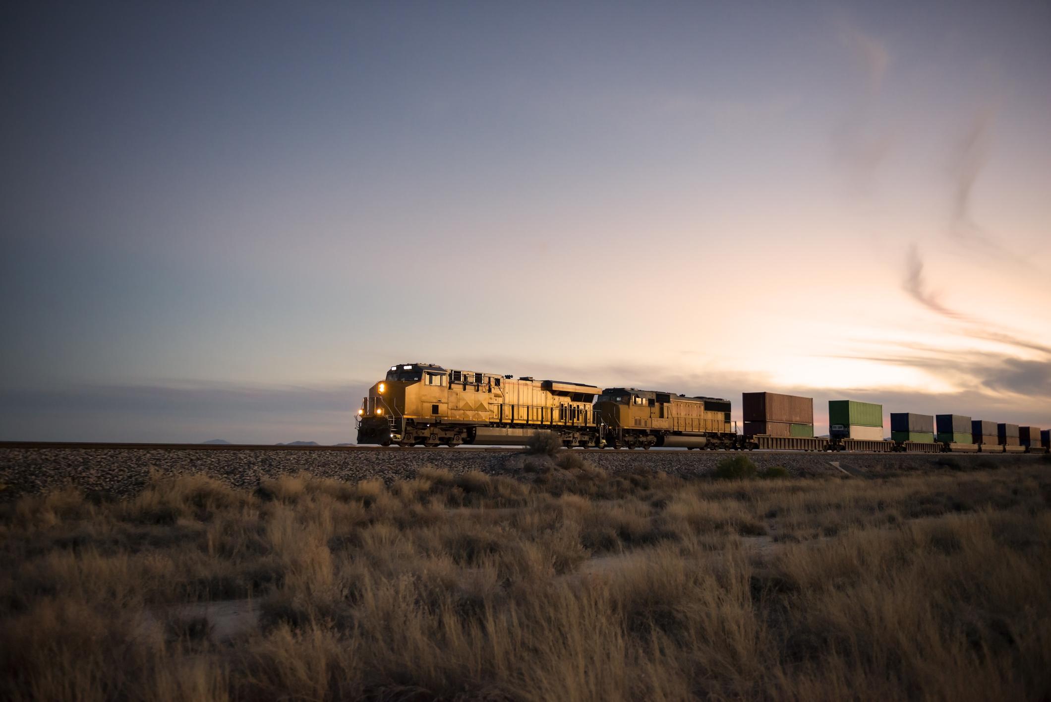 Railroad locomotive at dusk.