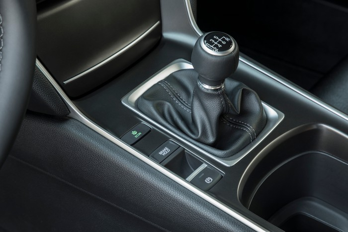 A close-up of the gearshift in a 2018 Honda Accord Sport equipped with six-speed manual transmission