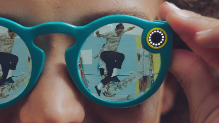 A skateboarder in the reflection of a Snap Spectacles wearer.