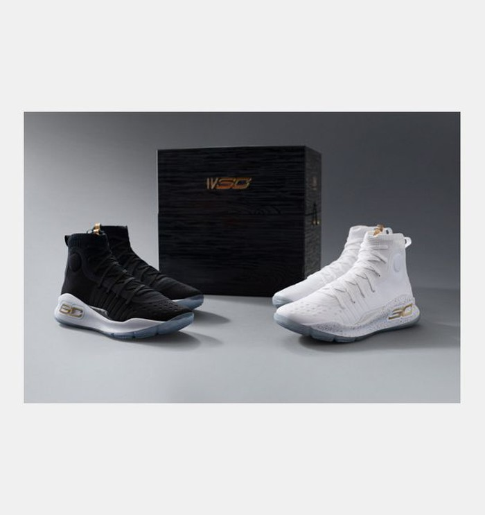 A black pair and white pair of Curry 4's in front of a black box